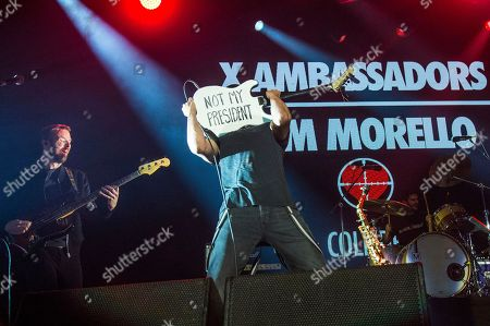 Noah Feldshuh, left, of X Ambassadors performs with Tom Morello at the 2016 KROQ Almost Acoustic Christmas at The Forum, in Inglewood, Calif