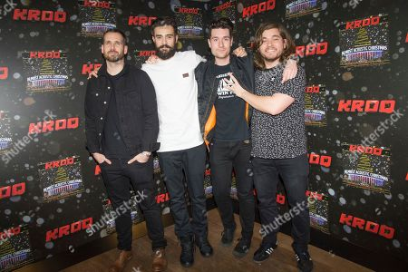 Will Farquarson, from left, Kyle J Simmons, Dan Smith, and Chris Wood of Bastille pose at the 2016 KROQ Almost Acoustic Christmas at The Forum, in Inglewood, Calif