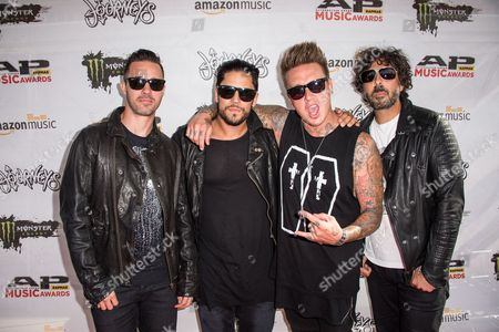 Jerry Horton, from left, Tobin Esperance, Jacoby Shaddix, and Tony Palermo of Papa Roach arrive at the 2016 Journeys AP Music Awards at Value City Arena at the Jerome Schottenstein Center, in Columbus, Ohio