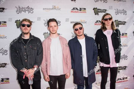 Eddy Brewerton, and Mark Osborne, Glenn Harvey, and Kyle Todd of Moose Blood arrive at the 2016 Journeys AP Music Awards at Value City Arena at the Jerome Schottenstein Center, in Columbus, Ohio