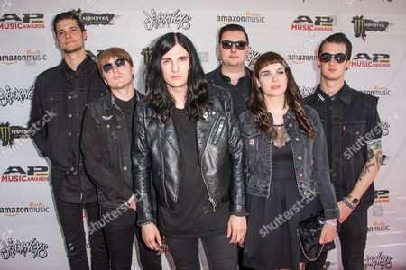 Stock Picture of Will Gould, from left, Ian Miles, Oliver Burdett, Sean Scott, and Hannah Greenwood, Dan Bratton of Creeper arrive at the 2016 Journeys AP Music Awards at Value City Arena at the Jerome Schottenstein Center, in Columbus, Ohio