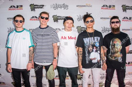 Stock Picture of Sam Bowden, from left, Fil Thorpe Evans, Ben Barlow, Dani Washington, and Matt West of Neck Deep arrive at the 2016 Journeys AP Music Awards at Value City Arena at the Jerome Schottenstein Center, in Columbus, Ohio