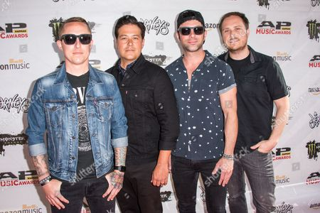 Ryan Key, from left, Sean Mackin, Josh Portman, and Ryan Mendez of Yellowcard arrive at the 2016 Journeys AP Music Awards at Value City Arena at the Jerome Schottenstein Center, in Columbus, Ohio
