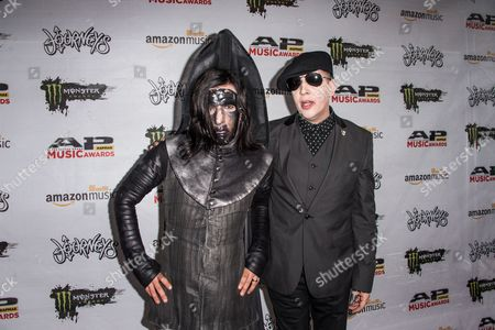 Twiggy Ramirez, left, and Marilyn Manson arrives at the 2016 Journeys AP Music Awards at Value City Arena at the Jerome Schottenstein Center, in Columbus, Ohio