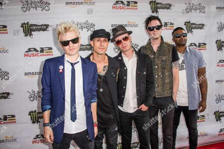 Deryck Whibley, Frank Zummo, Tom Thacker, Jason McCaslin, and Dave Baksh of Sum 41 arrive at the 2016 Journeys AP Music Awards at Value City Arena at the Jerome Schottenstein Center, in Columbus, Ohio