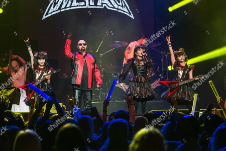 Yui Mizuno, from left, Rob Halford, Suzuka Nakamoto, and Moa Kikuchi of BABYMETAL perform at the 2016 Journeys AP Music Awards at Value City Arena at the Jerome Schottenstein Center, in Columbus, Ohio