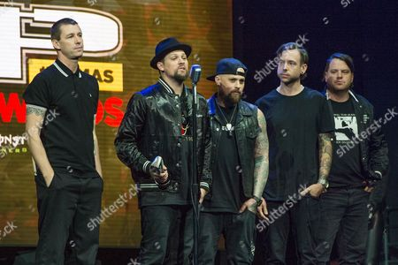Stock Photo of Dean Butterworth, from left, Joel Madden, Benji Madden, Billy Martin, and Paul Thomas of Good Charlotte speak at the 2016 Journeys AP Music Awards at Value City Arena at the Jerome Schottenstein Center, in Columbus, Ohio