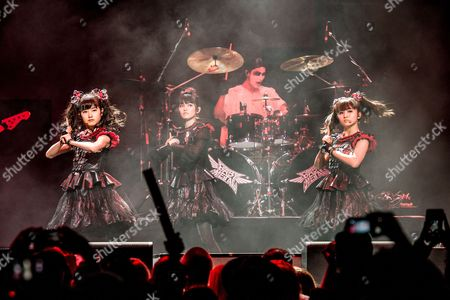 Yui Mizuno, from left, Suzuka Nakamoto, and Moa Kikuchi of BABYMETAL perform at the 2016 Journeys AP Music Awards at Value City Arena at the Jerome Schottenstein Center, in Columbus, Ohio