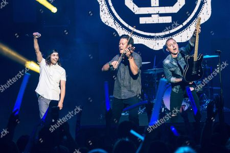 Vic Fuentes, left, of Pierce The Veil performs with Sean Mackin and Ryan Key of Yellowcard at the 2016 Journeys AP Music Awards at Value City Arena at the Jerome Schottenstein Center, in Columbus, Ohio
