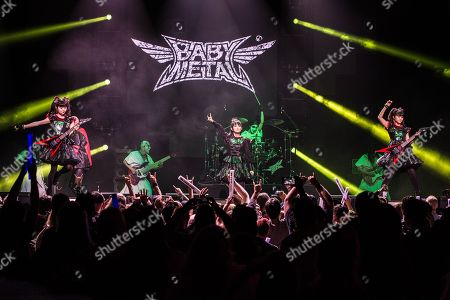 Rob Halford of Judas Priest performs with Yui Mizuno, from left, Suzuka Nakamoto, and Moa Kikuchi of BABYMETAL at the 2016 Journeys AP Music Awards at Value City Arena at the Jerome Schottenstein Center, in Columbus, Ohio