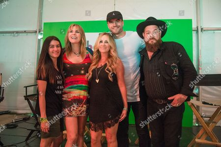 Leilani Munter, from left, Grace Potter, Lee Ann Womack, Sam Hunt, and Nathaniel Ratliff pose at Bonnaroo Music and Arts Festival, in Manchester, Tenn