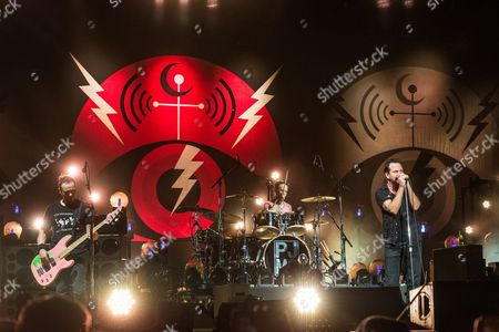 Jeff Ament, from left, Matt Cameron, and Eddie Vedder of Pearl Jam performs at Bonnaroo Music and Arts Festival, in Manchester, Tenn