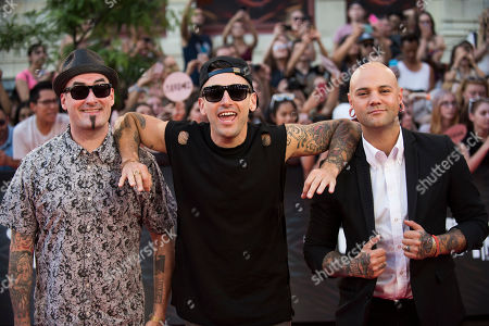 Tommy Mac, Jacob Hoggard and David Rosin of Hedley arrive at the 2016 iHeartRadio MuchMusic Video Awards, in Toronto, Canada