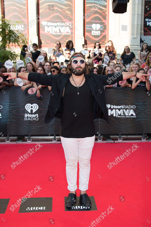 Coleman Hell arrives at the 2016 iHeartRadio MuchMusic Video Awards, in Toronto, Canada