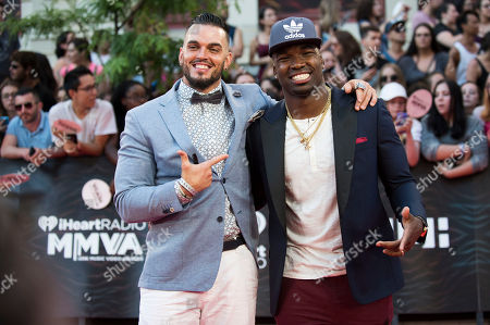 Ricky Foley and Simoni Lawrence arrive at the 2016 iHeartRadio MuchMusic Video Awards, in Toronto, Canada