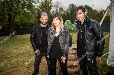 Stock Image of Mark Goodwin, from left, Emma Anzai, and Shimon Moore of Sick Puppies pose at the Louder Than Life Festival, in Louisville, Ky