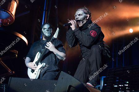 Mick Thomson, left, and Corey Taylor of Slipknot perform at the Louder Than Life Festival, in Louisville, Ky