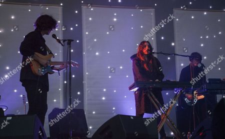 Alex Scally, Victoria Legrand, and Skyler Skjelset of Beach House seen at the 2016 Pitchfork Music Festival, on in Chicago