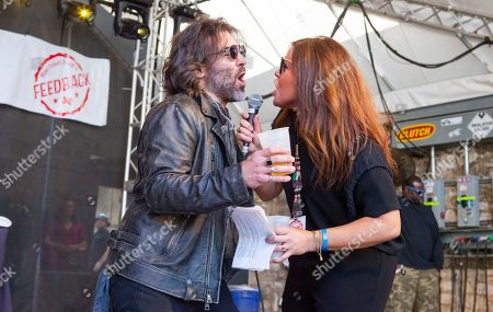 John Cusimano and Rachael Ray introduce Naughty by Nature at Rachael Ray's Feedback Party at Stubb's Bar-B-Que, during the South by Southwest Music Festival, in Austin, Texas