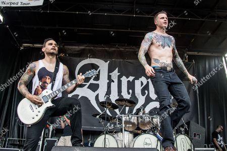 Travis Miguel, left, and Alex Varkatzas of Atreyu perform at the 2016 Vans Warped Tour at the Klipsch Music Center, in Noblesville, Indiana