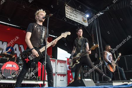 Deryck Whibley, from left, Jason McCaslin, and Dave Baksh of Sum 41 perform at the 2016 Vans Warped Tour at the Klipsch Music Center, in Noblesville, Indiana