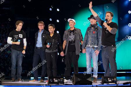 From left, Craig Kielburger, Mike Downie, Pearl Achneepineskum, William Achneepineskum, Gord Downie and Marc Kielburger seen during WE Day, in Toronto