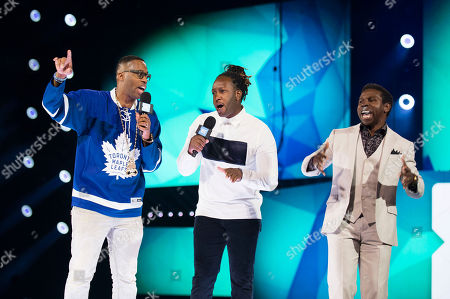 "From left, Kardinal Offishall, Michael ""Pinball"" Clemons and Tyrone Edwards speak on stage at WE Day, in Toronto"