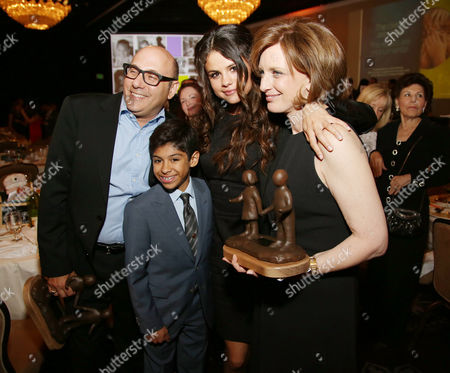 From left, Willie Garson, Nathen Garson, Selena Gomez, and Anne Sweeney attend the 22nd Annual Alliance for Children's Rights Dinner at The Beverly Hilton Hotel on in Beverly Hills, Calif
