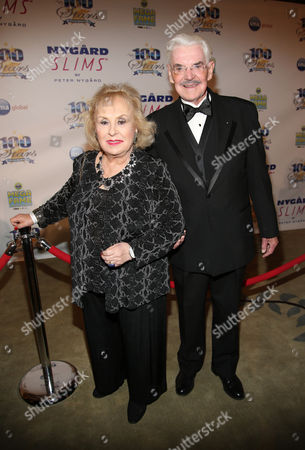 Stock Picture of Doris Roberts and Jack Betts arrive at the 24th Night of 100 Stars Oscars Viewing Gala at The Beverly Hills Hotel on in Beverly Hills, Calif