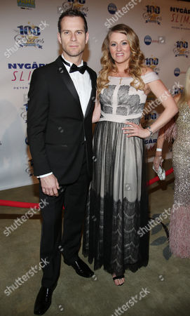 Nick Liam Heaney and Kayla Tabish arrive at the 24th Night of 100 Stars Oscars Viewing Gala at The Beverly Hills Hotel on in Beverly Hills, Calif