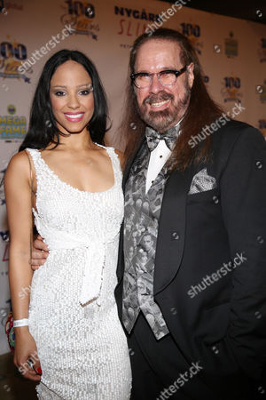 Marilinda Rivera and Lawrence Davis arrive at the 24th Night of 100 Stars Oscars Viewing Gala at The Beverly Hills Hotel on in Beverly Hills, Calif