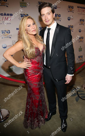 Adrienne Maloof and Jacob Busch arrive at the 24th Night of 100 Stars Oscars Viewing Gala at The Beverly Hills Hotel on in Beverly Hills, Calif