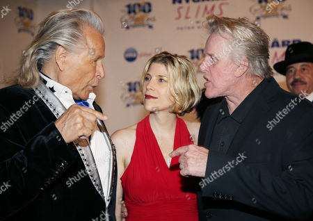 Peter Nygard, from left, Steffanie Busey, and Gary Busey arrive at the 24th Night of 100 Stars Oscars Viewing Gala at The Beverly Hills Hotel on in Beverly Hills, Calif