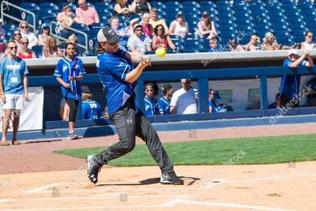 Jonathan Jackson gets a hit at the 26th Annual City of Hope Celebrity Softball Game at First Tennessee Park on in Nashville, Tenn