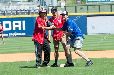 Bret Michaels, left, Barry Zito, and Charles Esten stand on second base at the 26th Annual City of Hope Celebrity Softball Game at First Tennessee Park on in Nashville, Tenn