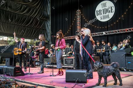 Stock Picture of Willie Nelson, from left, Jim James, and Pegi Young perform at the 30th Annual Bridge School Benefit Concert at the ShorelineAmphitheater, in Mountain View, Calif