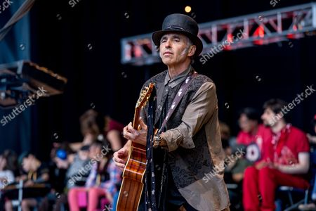 Stock Image of Nils Lofgren performs at the 30th Annual Bridge School Benefit Concert at the Shoreline Ampthitheatre, in Mountain View, Calif