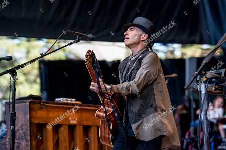 Nils Lofgren performs at the 30th Annual Bridge School Benefit Concert at the Shoreline Ampthitheatre, in Mountain View, Calif