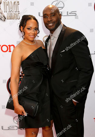 Stock Photo of Pam Byse, left, and Morris Chestnut arrive at the 45th NAACP Image Awards at the Pasadena Civic Auditorium, in Pasadena, Calif