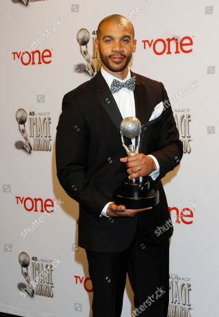 Aaron D. Spears poses in the press room with the award for the Outstanding Actor in a Daytime Drama Series award for 'The Bold and the Beautiful' at the 45th NAACP Image Awards at the Pasadena Civic Auditorium, in Pasadena, Calif
