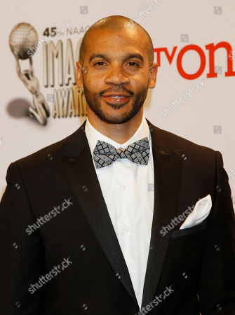 Aaron D. Spears poses in the press room at the 45th NAACP Image Awards at the Pasadena Civic Auditorium, in Pasadena, Calif