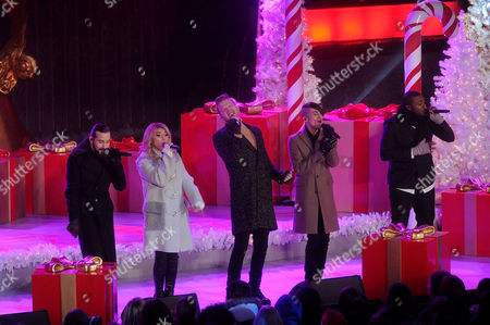 Pentatonix members Avi Kaplan, Kirstie Maldonado, Scott Hoying, Mitch Grassi, and Kevin Olusola perform during the 83rd Annual Rockefeller Center Christmas Tree Lighting Ceremony, in New York