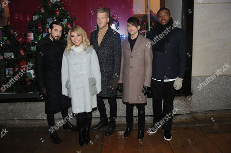 Stock Image of Pentatonix members Avi Kaplan, Kirstie Maldonado, Scott Hoying, Mitch Grassi, and Kevin Olusola poses for a photo during the 83rd Annual Rockefeller Center Christmas Tree Lighting Ceremony, in New York