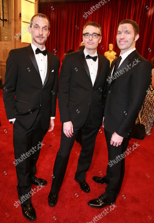 Anthony Stacchi, from left, Graham Annable and Travis Knight arrives at the Oscars, at the Dolby Theatre in Los Angeles