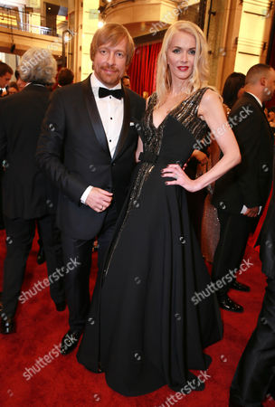 Morten Tyldum, left, and Janne Tyldum arrive at the Oscars, at the Dolby Theatre in Los Angeles