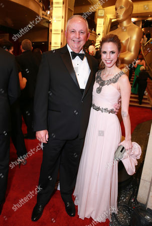 Stock Image of Dick Cook, left, and Roxanne Cook arrives at the Oscars, at the Dolby Theatre in Los Angeles