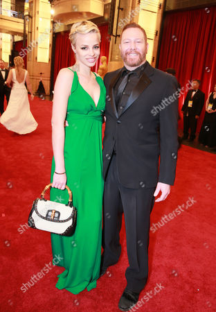 Jessica Roffey, left, and Ryan Kavanaugh, Chief Executive Officer of Relativity Studios arrives at the Oscars, at the Dolby Theatre in Los Angeles