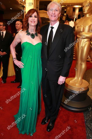 Jamie McGurk, left, and Cinedigm Chairman of the Board & Chief Executive Officer Chris McGurk arrive at the Oscars, at the Dolby Theatre in Los Angeles