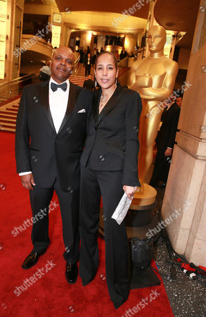 Reggie Rock Bythewood, left, and Gina Prince-Bythewood arrive at the Oscars, at the Dolby Theatre in Los Angeles