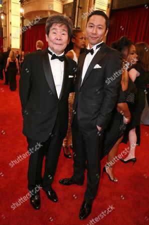 Isao Takahata and Yoshiaki Nishimura arrives at the Oscars, at the Dolby Theatre in Los Angeles